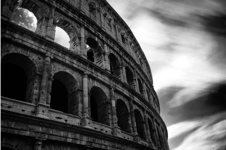 A black and white photograph of the Colosseum, Rome. This photograph has been made with a long exposure technique