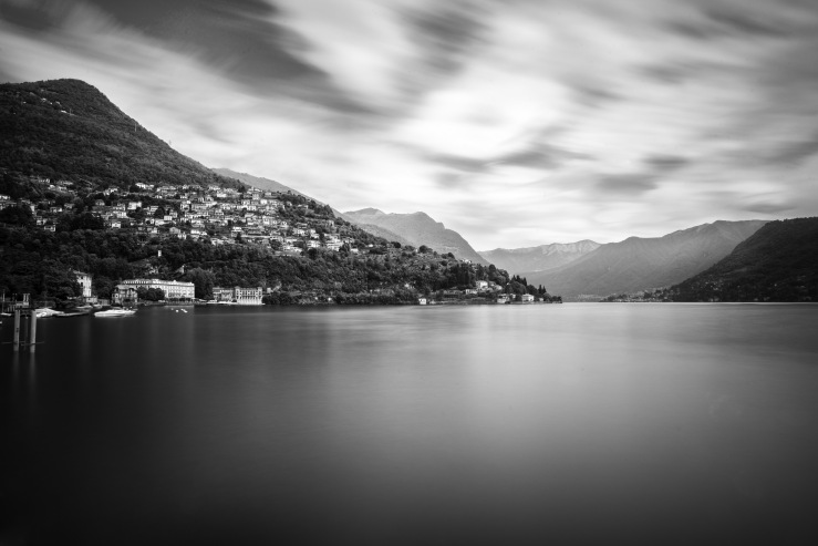 A long exposure black and white landscape photograph of Como Lake, Cernobbio