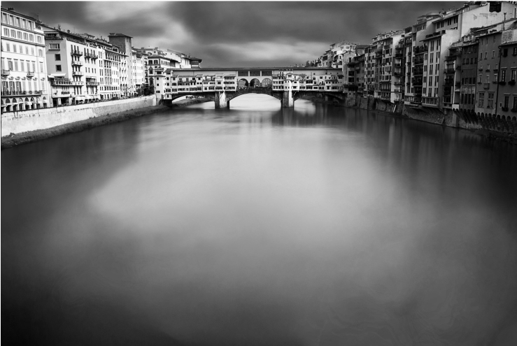 A black and white long exposed cityscape of Ponte Vecchio, Florence, Italy
