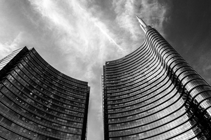 A black and white cityscape photograph of the Unicredit Tower, Milan
