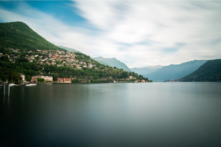 A landscape photograph of Lake Como, Italy. It has been pictured using a long exposure technique