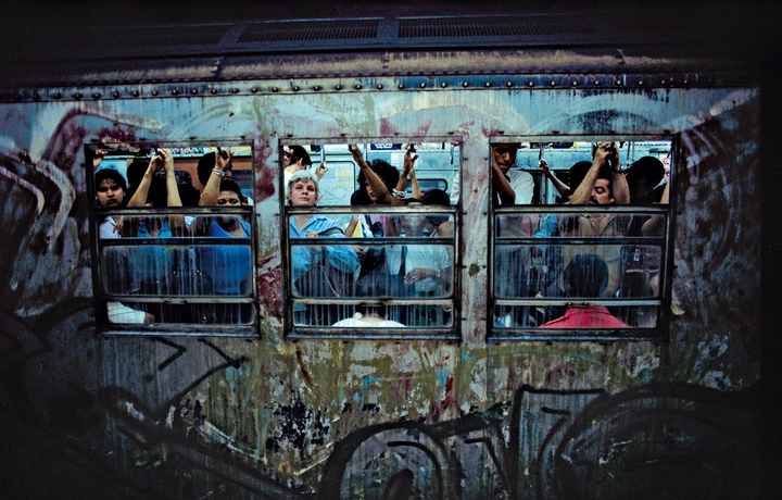 A photograph by Bruce Davidson, showing the grid trains of the New York subway