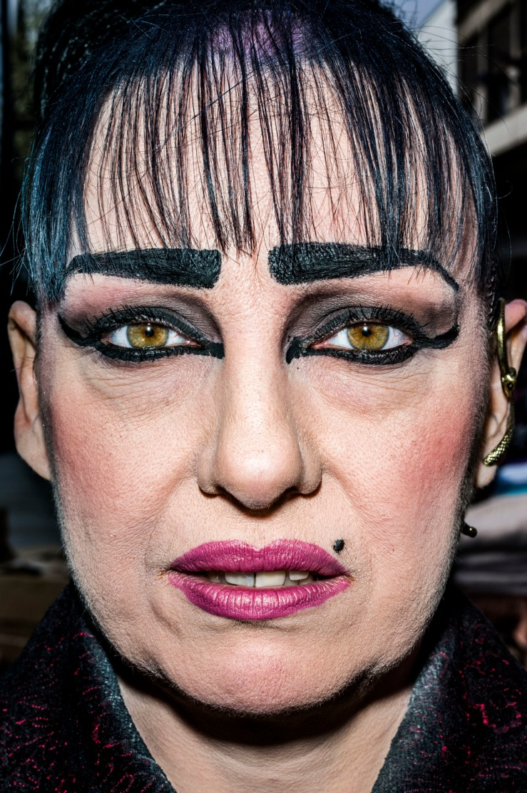 Bruce Gilden's photograph close ups photograph of a woman with heavy makeup