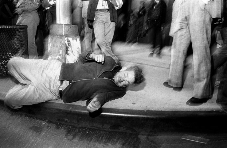 Bruce Gilden's photograph of a drunk man on the street