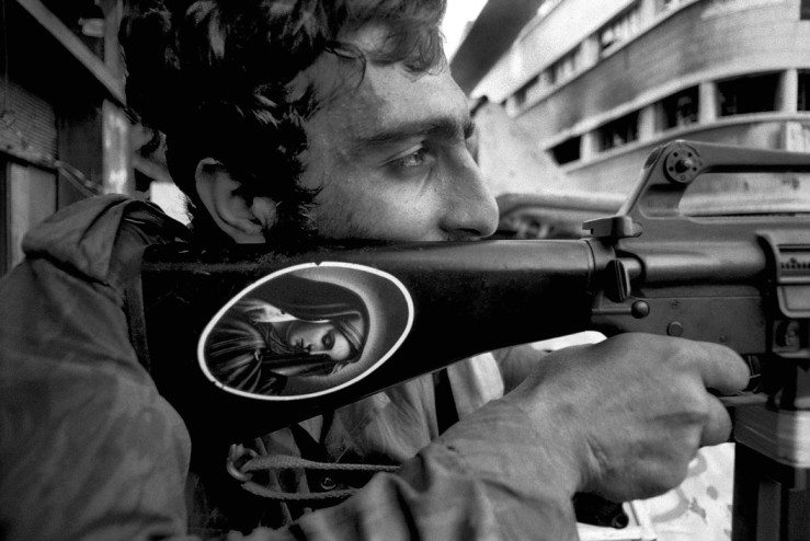 Ferdinando Scianna's black and white image of a man holding his rifle during the Lebanese civil war